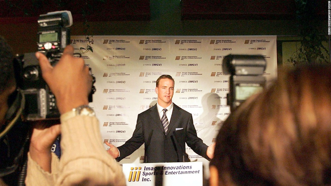 "Manning talks to the media after signing a deal with a sports memorabilia company in 2005. Manning's ""everyman"" persona has also made him a popular pitchman for brands such as Gatorade, Papa John's and Nationwide."