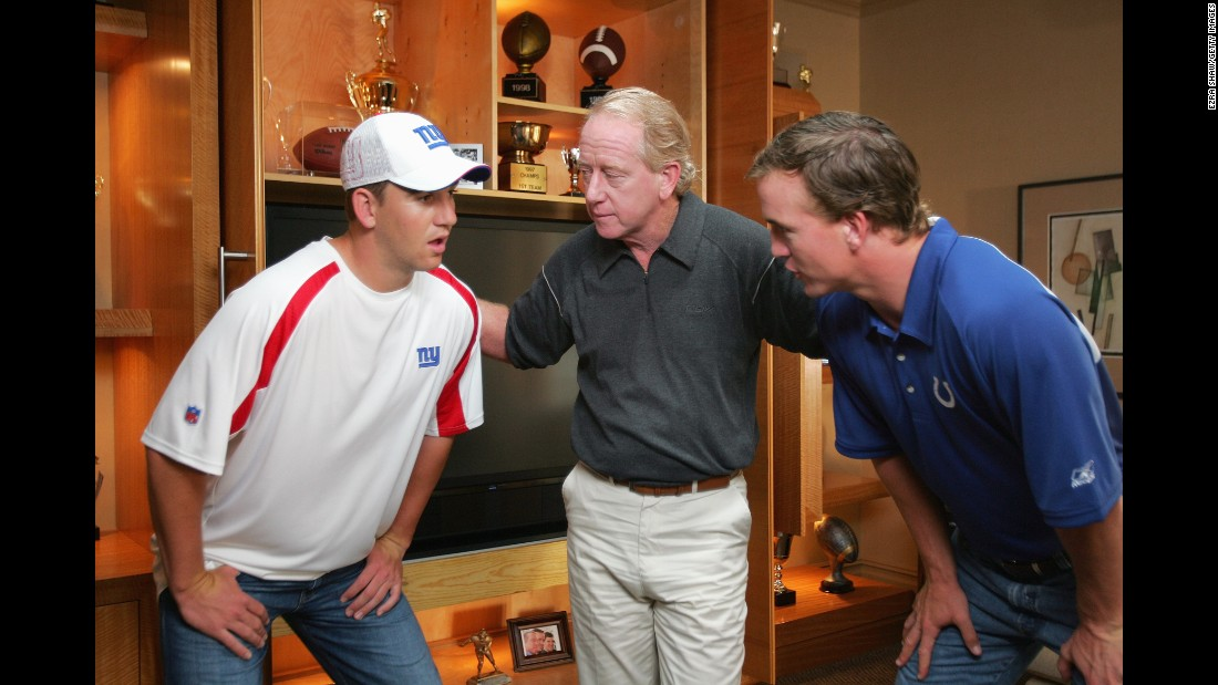 Manning, right, shoots a Reebok commercial in 2006 with his brother Eli and their father, Archie. Archie was an NFL quarterback from 1971-1984, and Eli has won two Super Bowls as quarterback of the New York Giants.
