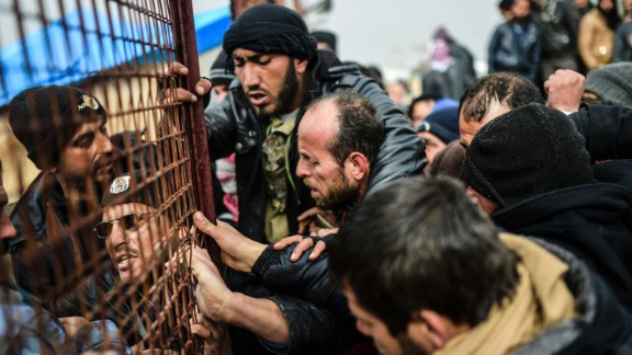 Refugees jostle one another for tents near the Turkish border on February 6.