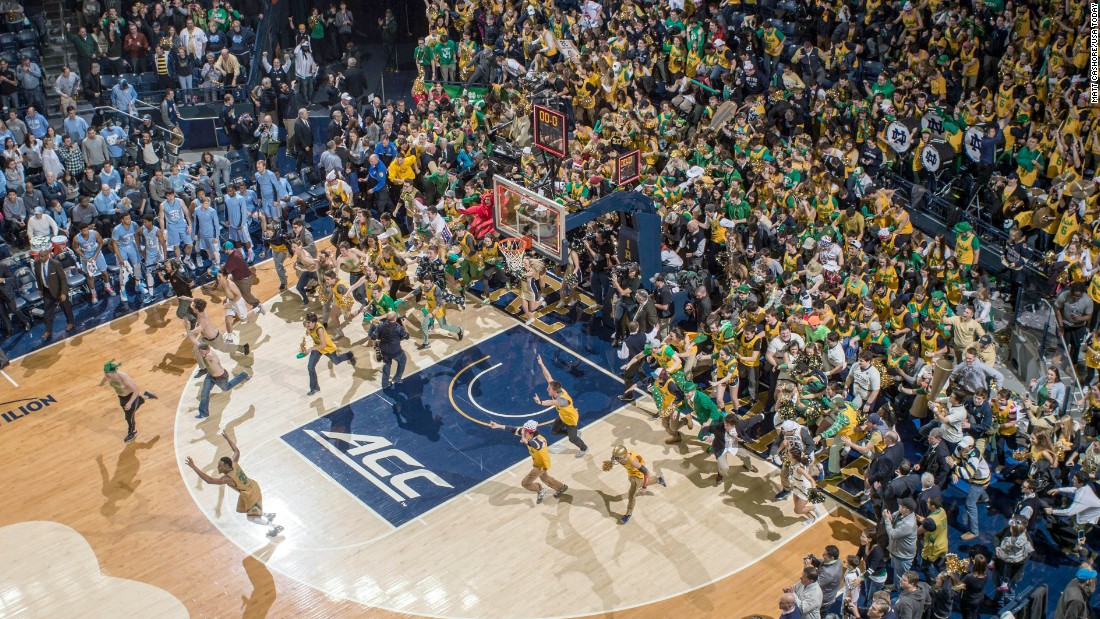 Notre Dame students storm their home court after the men's basketball team defeated No. 2 North Carolina on Saturday, February 6.