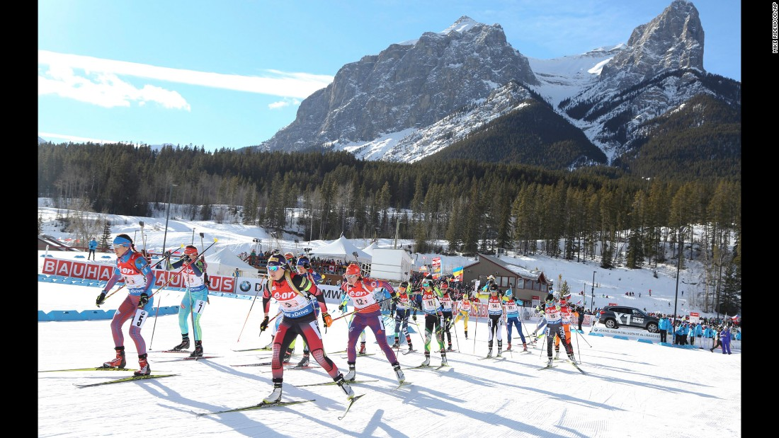 Biathletes leave the start area of a World Cup race in Canmore, Alberta, on Sunday, February 7.