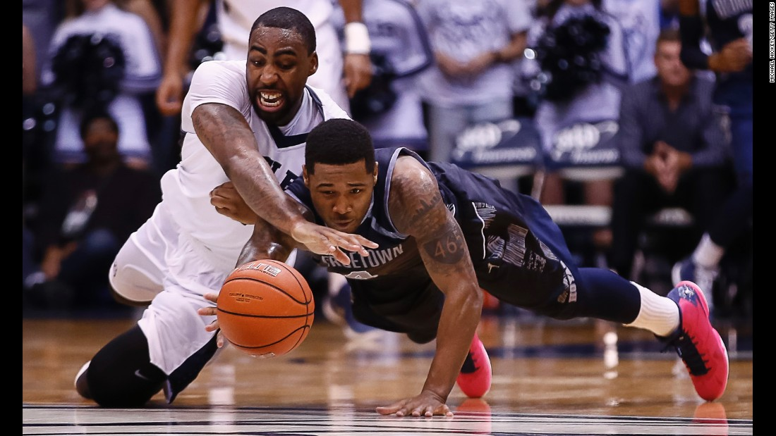 Butler's Roosevelt Jones, left, competes for a loose ball with Georgetown's D'Vauntes Smith-Rivera during a Big East basketball game in Indianapolis on Tuesday, February 2.