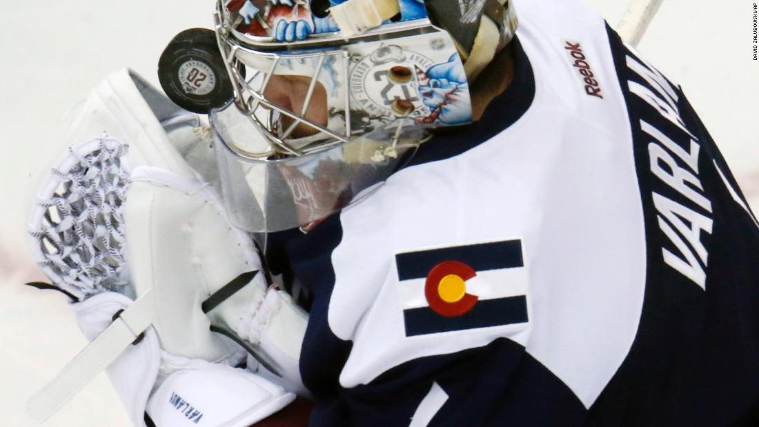 Colorado goalie Semyon Varlamov is hit in the mask with a puck as he tries to make a save during an NHL game in Denver on Saturday, February 6.