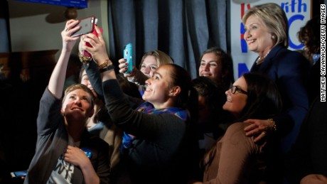 Democratic presidential candidate former Secretary of State Hillary Clinton, poses for selfies with supporters at a debate watching party on February 4,  in Durham, New Hampshire. Clinton is campaigning in the lead up to the The New Hampshire primary, February 9.