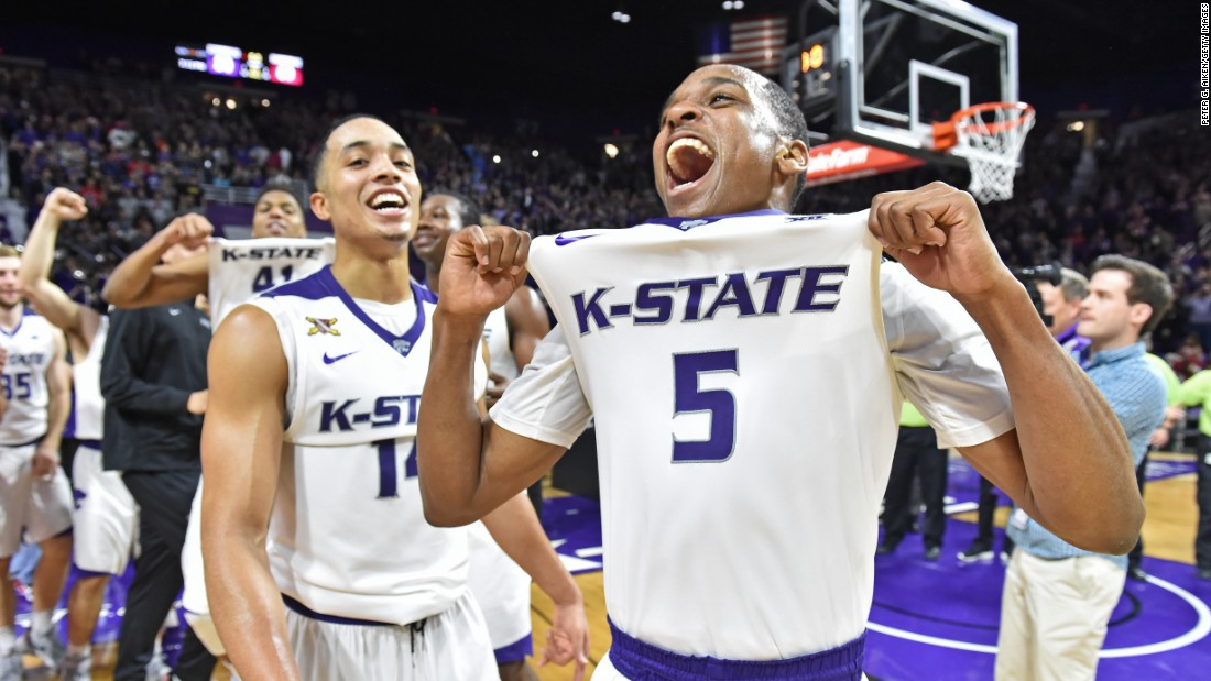 Kansas State guard Barry Brown (No. 5) celebrates with his teammates after they knocked off No. 1 Oklahoma on Saturday, February 6. The Wildcats won 80-69 in Manhattan, Kansas.