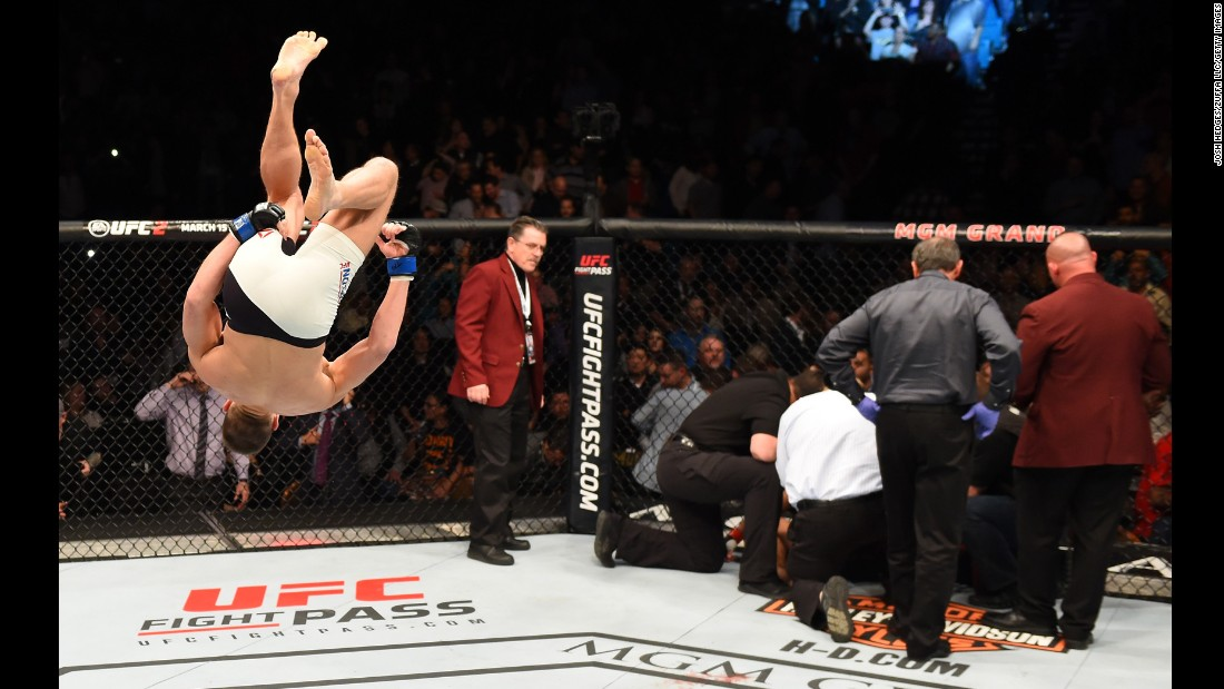 UFC fighter Stephen Thompson flips in celebration after he knocked out Johny Hendricks in Las Vegas on Saturday, February 6.