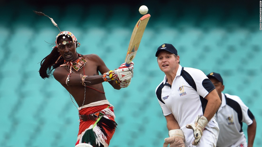 A Maasai warrior from Kenya plays a shot during a cricket match in Sydney on Thursday, February 4. A team of Maasai warriors is touring the world to play cricket and raise awareness of issues such as HIV/AIDS and female genital mutilation.