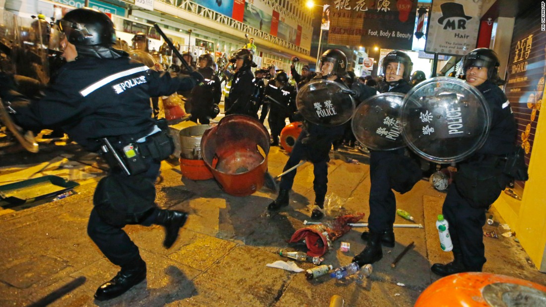 Riot police advance on protesters in a street in Mong Kok on February 9.