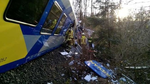 Rescue workers at the site of the train collision near Bad Aibling, Germany, on Tuesday.