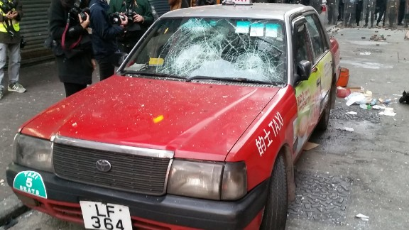 The windshield of a taxi is smashed by bricks on February 9.
