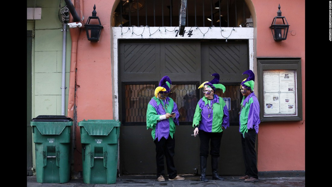 Mardi Gras revelers hang out in New Orleans' French Quarter on February 9.