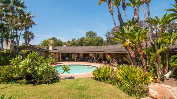 """The main house was designed by architect Cliff May, known for his """"California Ranch House,"""" which typically features a long, low roof. Stretching over 5,000 square feet, Winfrey's new house features four bedrooms, four fireplaces, and overlooks a pool."""