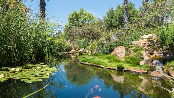 The 23-acre estate includes a fish pond ...