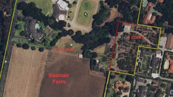 Seamair Farm, pictured with Google Earth. Huge brown paddocks sprawl across the bottom of the image, while an avocado grove is outlined on the right.