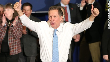 Republican presidential candidate Ohio Governor John Kasich waves to the crowd after speaking at a campaign gathering with supporters upon placing second place in the New Hampshire republican primary on February 9, 2016 in Concord, New Hampshire.