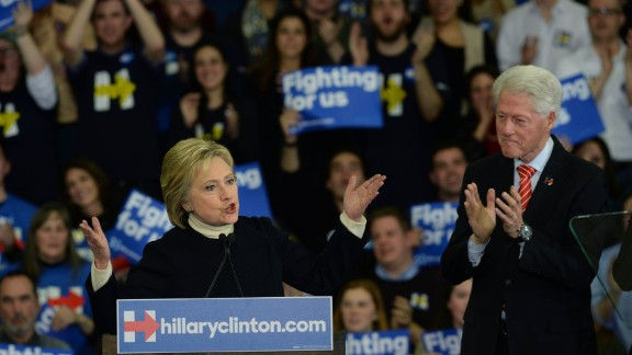 Democratic presidential candidate Hillary Clinton speaks as husband, former President Bill Clinton looks on at Southern New Hampshire University February 9, 2016 in Hooksett, New Hampshire.