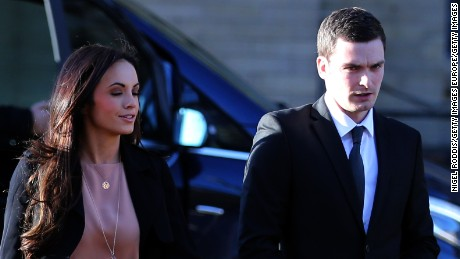 Adam Johnson arrives with girlfriend Stacey Flounders at the Crown Court on February 10, 2016 in Bradford, England.