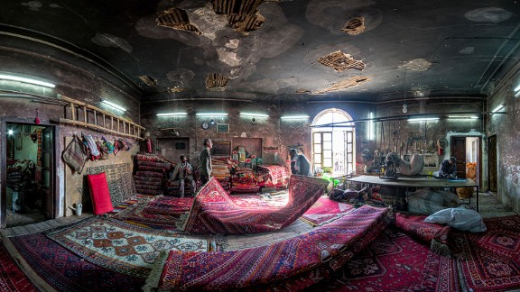 """Carpet-making is one of the oldest and most important industries in Iran, says Ganji. """"I tried to capture the spirit of life which exists in this workshop and its workers. Every carpet brought here to be repaired has a spirit too."""""""