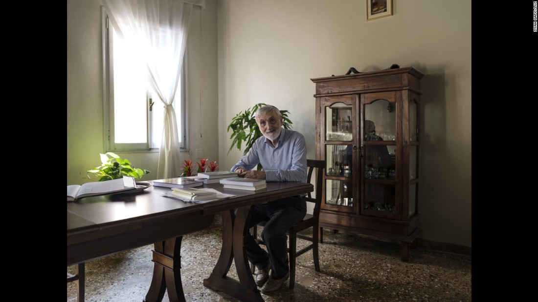 Rabbi Scialom Bahbout is seen in the dining room of his ghetto residence. He left Libya in 1968 and has lived in Venice for decades.