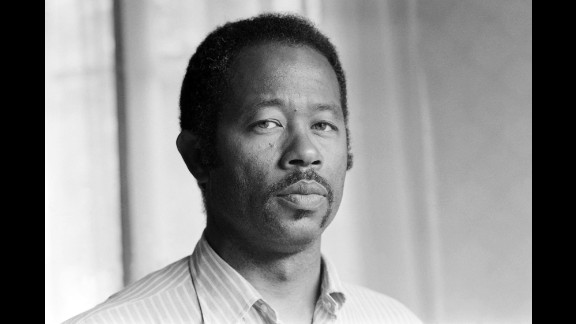 """Eldridge Cleaver, one of the original members of the radical Black Panther Party, poses in Paris in May 1975.  Appointed the Panthers' minister of information, Cleaver wrote """"Soul on Ice,"""" regarded as a handbook of the movement that preached violence and revolution as the only means to achieve black liberation in America. He fled the U.S. in the late '60s and after three years in exile turned his back on the Black Panthers.   Cleaver returned to the U.S. in 1975 to face justice. Denouncing his former movement, he was given a conditional release and sentenced to 2,000 hours of community service."""