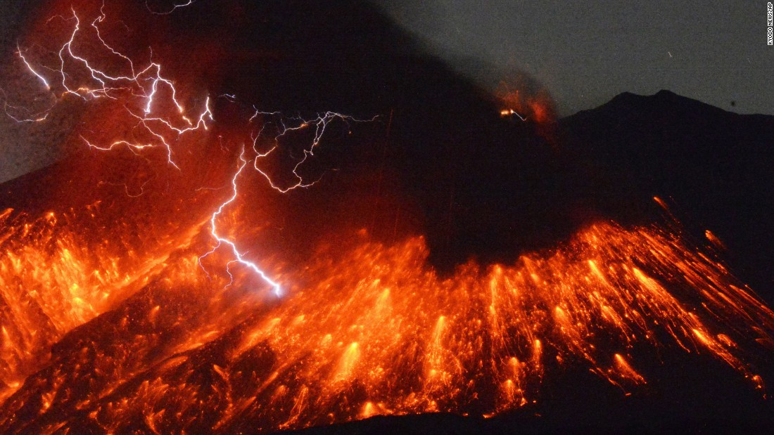Lightning flashes above Japan's Sakurajima volcano as it erupts on Friday, February 5.