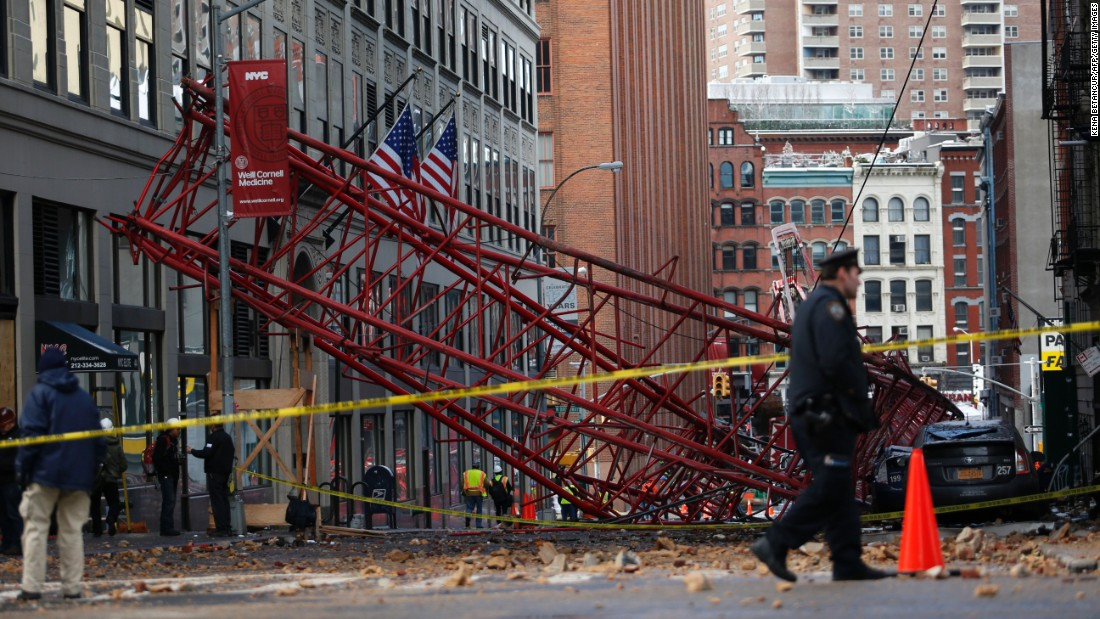 "A construction crane lies on a New York street <a href=""http://www.cnn.com/2016/02/05/us/new-york-crane-collapse/"" target=""_blank"">after it collapsed in Lower Manhattan</a> on Friday, February 5. One person was killed and three others were injured."