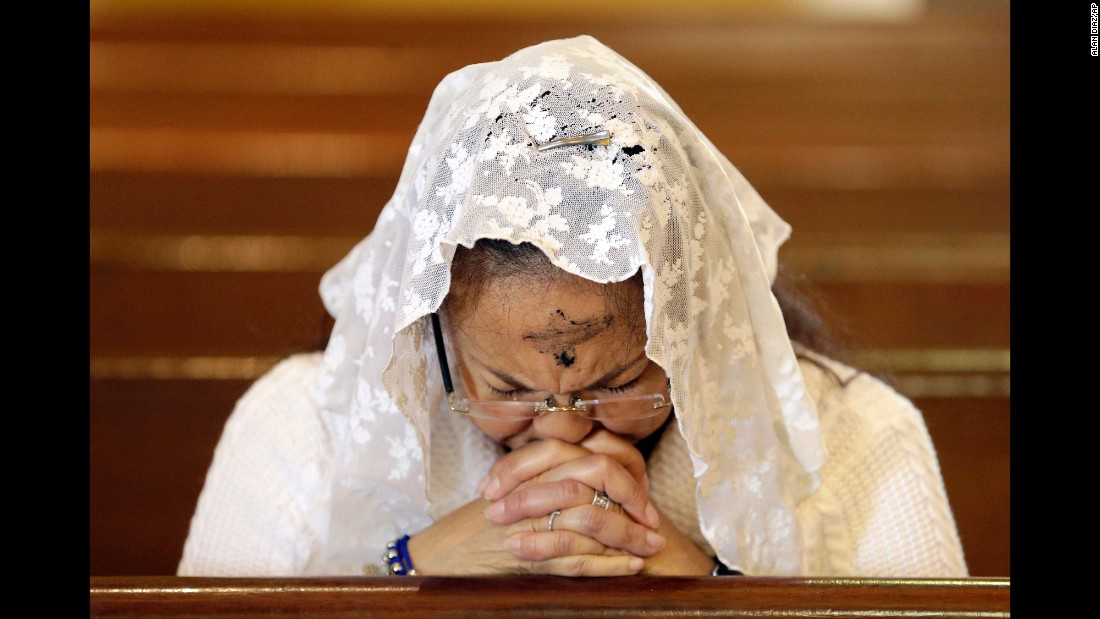 A woman prays at a Miami church on Ash Wednesday, February 10.
