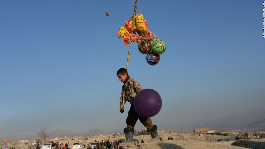 "A young balloon vendor waits for customers as he walks through a cemetery in Kabul, Afghanistan, on Friday, February 5. <a href=""http://www.cnn.com/2016/02/05/world/gallery/week-in-photos-0205/index.html"" target=""_blank"">See last week in 33 photos</a>"