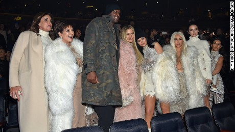 Lamar Odom poses with members of the Kardashian and Jenner families.