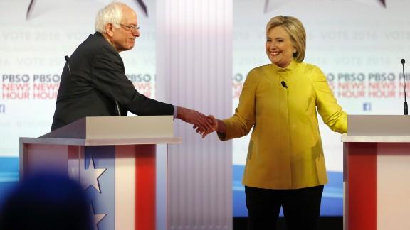 Democratic presidential candidates, Sen. Bernie Sanders, I-Vt, and Hillary Clinton shake hands after a Democratic presidential primary debate at the University of Wisconsin-Milwaukee, Thursday, Feb. 11, 2016, in Milwaukee. (AP Photo/Morry Gash)