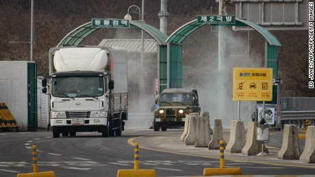 A vehicle leaving the Kaesong joint industrial zone passes through disinfectant spray before a checkpoint at the CIQ immigration centre near the Demilitarized Zone (DMZ) separating North an South Korea, in Paju on February 11, 2016.