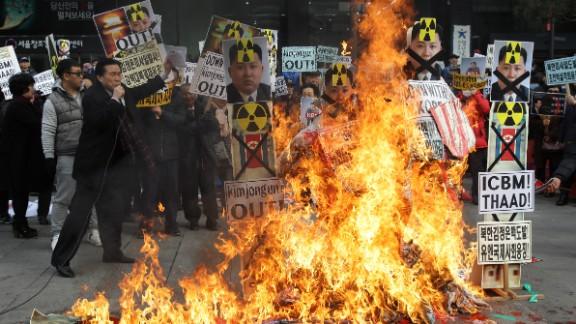 South Korean protesters burn an effigy of North Korea leader Kim Jong-Un during an anti-North Korea rally on February 11, 2016 in Seoul, South Korea. South Korea announced that it would close an industrial complex jointly ran with North Korea.