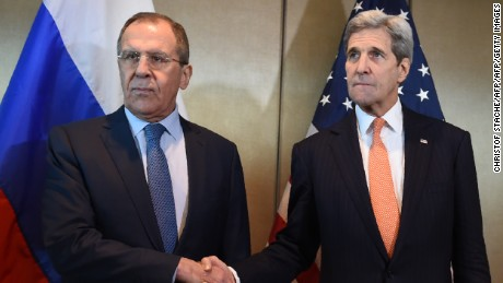 Russian Foreign Minister Sergei Lavrov (L) and US Secretary of States John Kerry shake hands as they meet for diplomatic talks on February 11, 2016 in Munich, southern Germany.