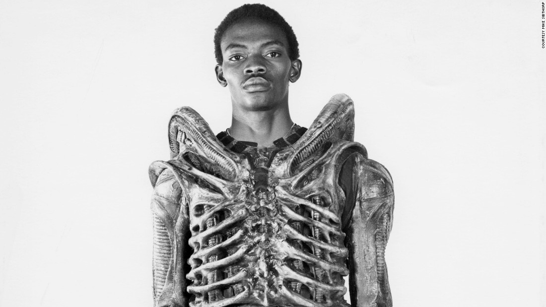 "Bolaji Badejo became one of cinema's most feared villains almost by accident. After a lengthy casting process, agent Peter Ardram came across Badejo in a pub in London. Thinking that the 6'10"" Nigerian matched the thin, insect-like profile director Ridley Scott required, he arranged for the two to meet. (Image: courtesy<a href=""http://www.mikesibthorp.com/"" target=""_blank""> Mike Sidthorp</a>.)"
