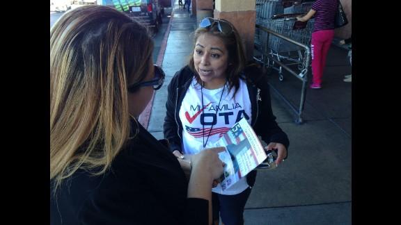 The nonpartisan organization Mi Familia Vota campaigns outside supermarkets in Las Vegas in a drive to register more Latinos to vote.