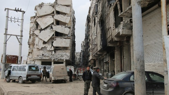 In this Thursday, Feb. 11, 2016 photo, a building is seen with heavy damage in Aleppo, Syria. The fighting around Syria