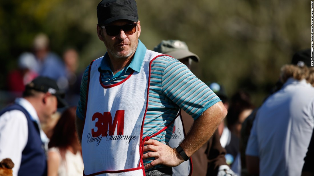 Is that Harrison Ford? No, it's actually five-time major-winner, Nick Faldo, on caddy duty at Pebble Beach.
