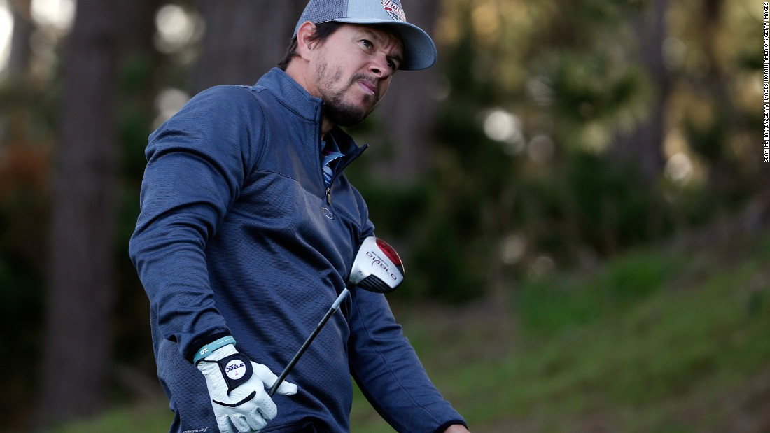 "Actor and star of films such as ""Ted"" and ""The Departed,"" Mark Wahlberg, urges on a tee-shot at Pebble Beach."