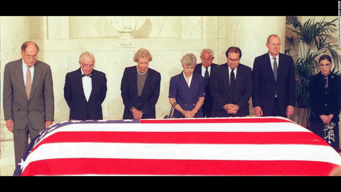 U.S. Supreme Court justices pay their respects in front of the casket of former Chief Justice Warren E. Burger during a prayer ceremony in the Great Hall at the Supreme Court Building in Washington on June 28, 1995.