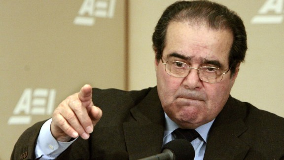 "Scalia calls on people during a question-and-answer period at the American Enterprise Institute on February 21, 2006, in Washington. Scalia delivered the keynote address about foreign law and the debate about how it is used in American Law during the seminar called ""Outsourcing Of American Law."""