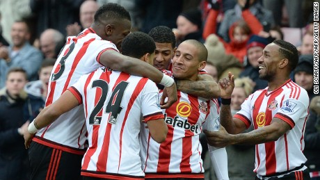 Sunderland's French-born Tunisian midfielder Wahbi Khazri (center) celebrates scoring his team's first goal against Manchester United.