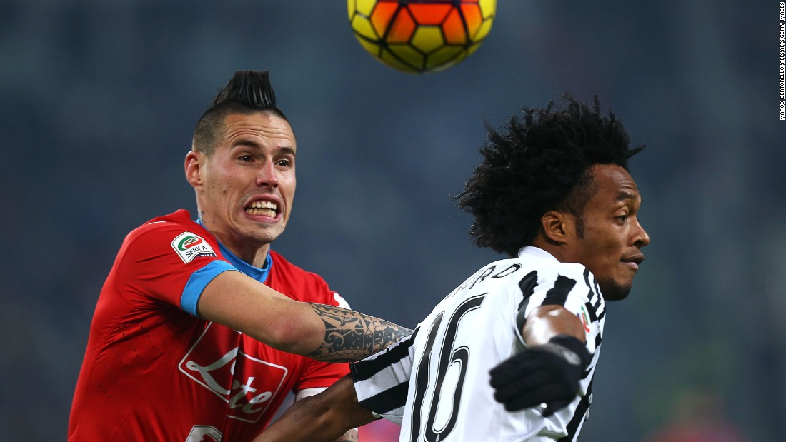 Napoli's Slovakian midfielder Marek Hamsik (L) vies for the ball  for the ball with Juve's Colombian midfielder Juan Cuadrado.