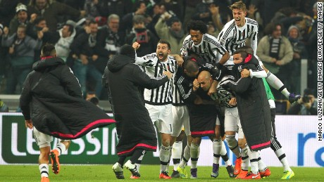 Simone Zaza (center) celebrates with his team-mates after scoring during the Serie A match between Juventus and Napoli.