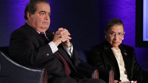 "Supreme Court Justices Antonin Scalia (L) and Ruth Bader Ginsburg (R) wait for the beginning of the taping of ""The Kalb Report"" April 17, 2014 at the National Press Club in Washington, DC."