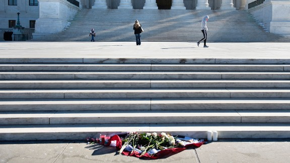 Flowers are seen as people visit the US Supreme Court February 14, 2016 in Washington.