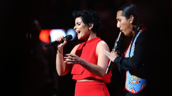Singer Nelly Furtado performs the Canadian national anthem with flute player Tony Duncan at the NBA All-Star Game on Sunday.