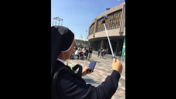 "MEXICO: Sister Cindy from Lima, Peru is filming her visit to Mexico -- following the Pope. She will sing with her band before the mass in Juarez. ""I told my community back home my challenge will be to get a selfie with Pope Francis"", she giggles. Photo by CNN's Miguel Castro @sambassando, February 11."