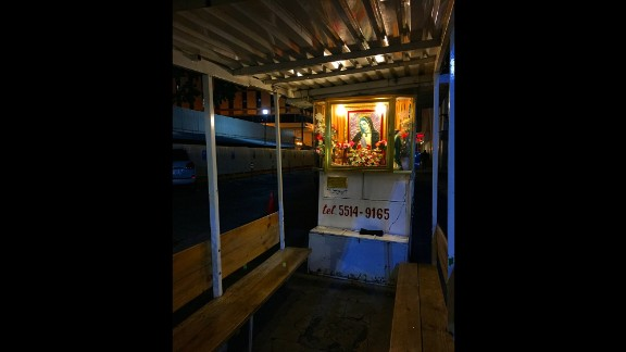 "MEXICO: ""A little chapel to Our Lady of Guadalupe is lit at an empty taxi stand in Mexico City. She is the patron saint of Mexico and one of the most revered saints in Latin America."" - CNN's Miguel Castro @sambassando."
