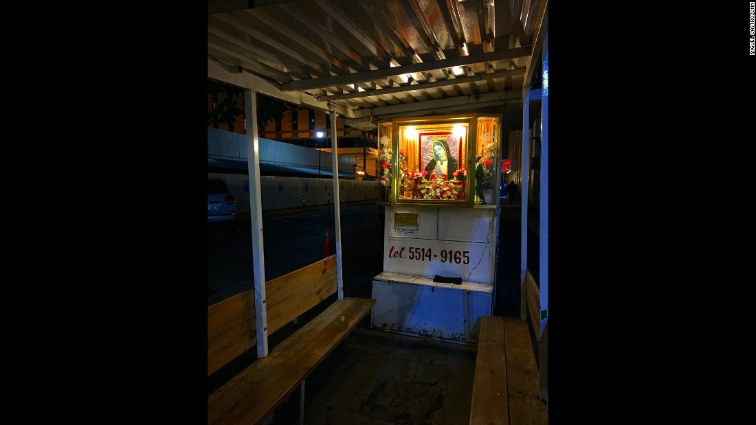 "MEXICO: ""A little chapel to Our Lady of Guadalupe is lit at an empty taxi stand in Mexico City. She is the patron saint of Mexico and one of the most revered saints in Latin America."" - CNN's Miguel Castro <a href=""http://instagram.com/sambassando"" target=""_blank"">@sambassando</a>."