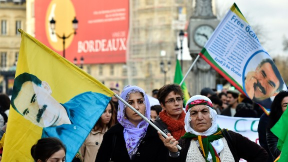 People wave flags with the portrait of the jailed leader of the Kurdistan Workers Party (PKK) Abdullah Ocalan during a demonstration in Bordeaux on January 23, 2016 called by associations for the defence of the Kurdish people and the